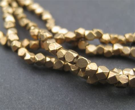 240 faceted brass 2mm tiny cut brass