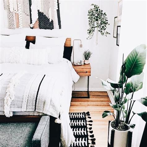 chic bedroom white walls wood floor decor plant