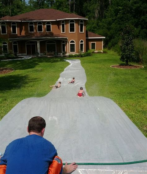 Backyard Slip N Slide by 24 Things You Definitely Need To Set Up In Your Backyard This Summer