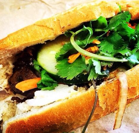 the sign picture of lotus cafe banh mi sandwiches