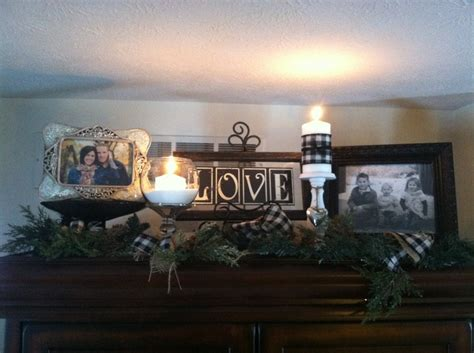winter decor on top of my entertainment center pinning