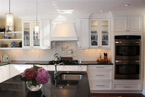 white glass backsplash kitchen kitchen colors with wood stainless steel arc high faucet dark wood floors with