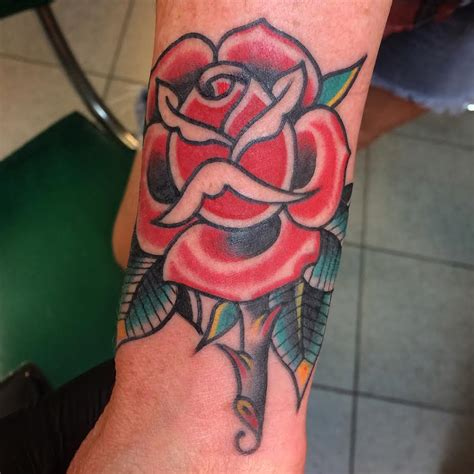 rose tattoo traditional traditional on sleeve