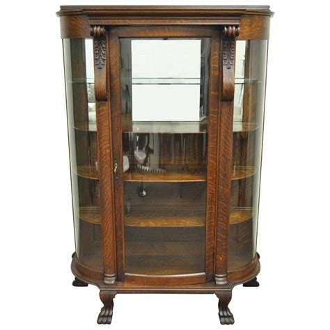 antique tiger oak bow front curved glass and mirror curio