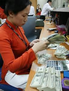 a bank teller counts dollar banknotes the remittance