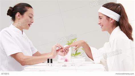 Getting A Manicure by Getting A Manicure At Nail Salon Lizenzfreie
