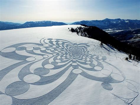 photos of snow expansive geometric drawings trled in snow and sand by