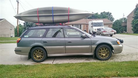 subaru outback rally wheels gold wheels kayaks rally lights and mudflaps all the