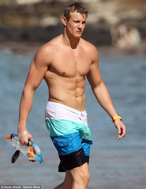 Alexander Ludwig Delights A Young Fan As He Lifts Her Up For A Photo While Holidaying In Hawaii