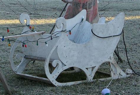 santa and sleigh yard art folk outside santa displays from family