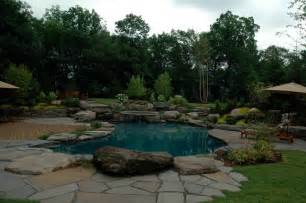 Large Landscape Rocks by Natural Lagoon Pool Traditional Pool New York By