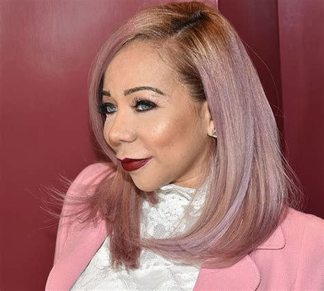 tiny harris damn that belly tiny harris shows she s self conscious