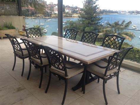 stylish outdoor patio tables with faux marble top on