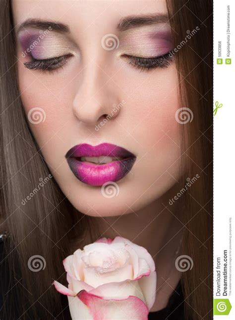 woman face  lilac lips  rose flower stock photo