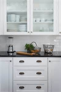 kitchens with white cabinets and black countertops best 25 black granite countertops ideas on