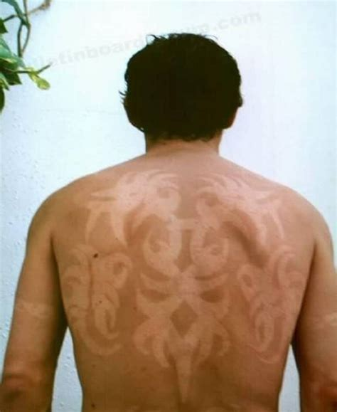 tanning after tattoo 10 awesome tattoos made using suntans