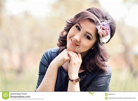 cute beautiful close up portrait of beautiful cute girl with wreath of