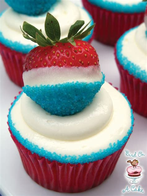 cupcakes and bird on a cake white and blue strawberry cupcakes