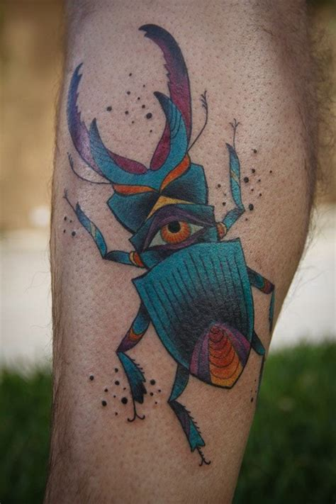 vivid tattoo colors stag beetle with eye on leg