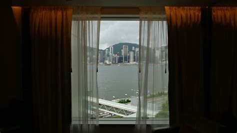 hotel window curtains view from a hong kong hotel window over victoria bay to