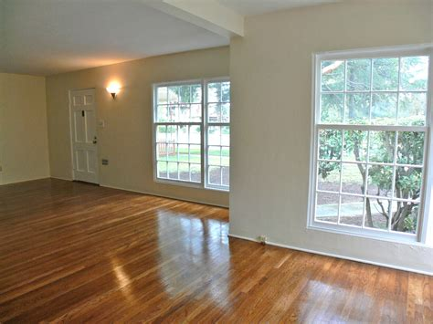 window wooden flooring with large windows and wall