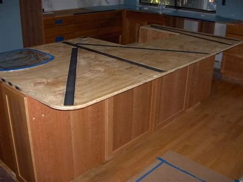 standard bar top overhang do this rather than have corbels or legs in island for