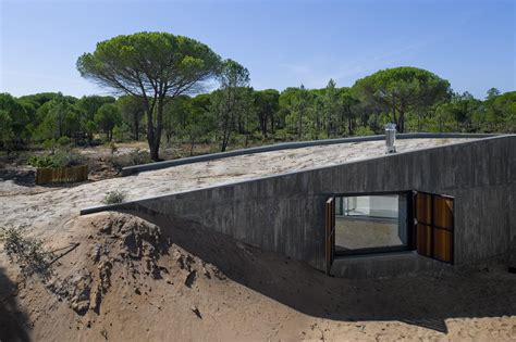 concrete house buried artificial sand dunes modern