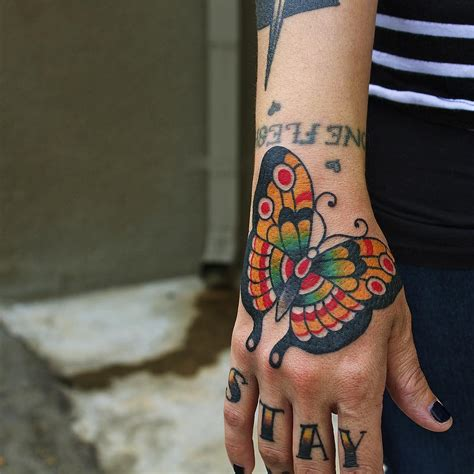 butterfly tattoo in hand traditional tattoos best tattoo ideas gallery part 2