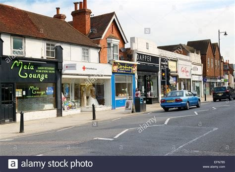 high street shops dorking surrey england uk stock photo