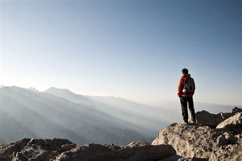 man standing on mountain top get started