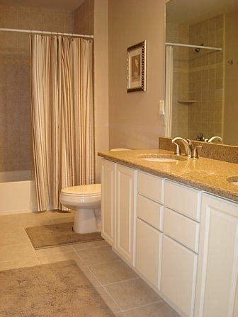 white cabinets with beige granite