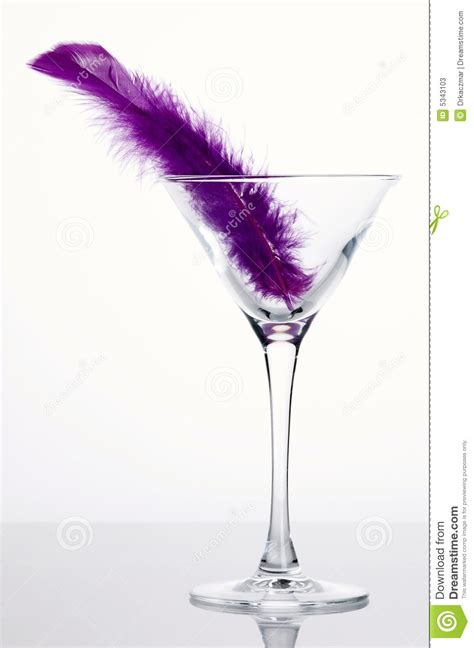 martini purple martini glass with purple feather stock photos image
