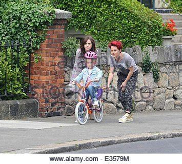 actress with bright red hair actress lily collins and jamie winstone with bright red