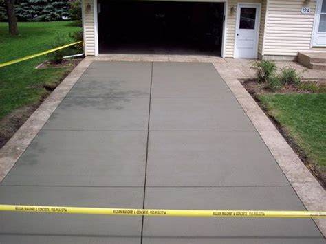 natural gray concrete driveway with seamless italian slate textured 12 quot border mendota buff