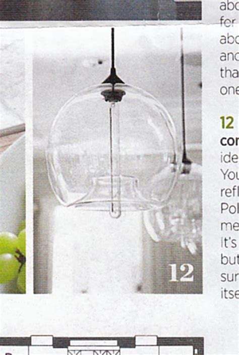 kitchen island lighting featured in traditional home magazine