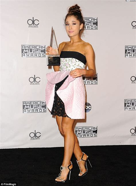 what does ariana grande wear to a party ariana grande wears onesie pajamas as she takes her dog on