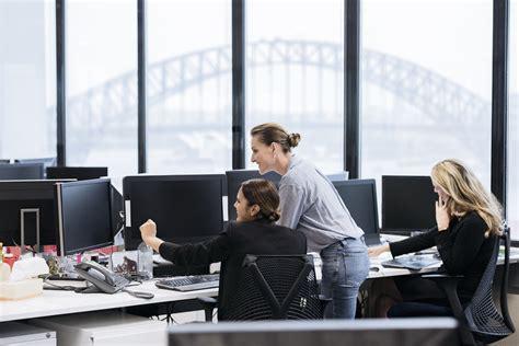 professional businesswomen in australian office working on