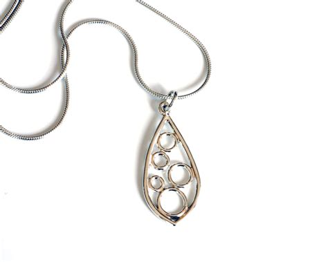 Handmade Canadian Jewelry - small silver wire pod pendant handmade by canadian jewelry