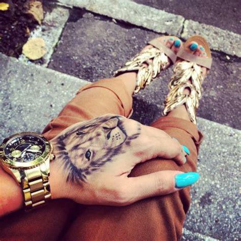 lion tattoo on hand 38 tattoos on
