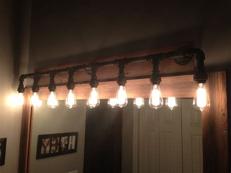 over vanity light fixtures built a vanity light from black iron pipe i got at lowe s