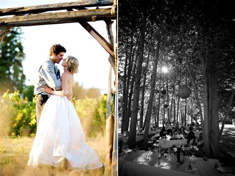 casual backyard wedding marne s blog bride and groom kiss under wood wedding arch