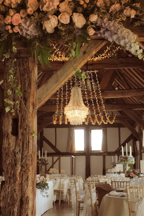 Crystal Chandelier With A Fairy Light Canopy At The Chandelier For Wedding