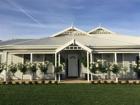Stilt House Designs grey weatherboard house colours
