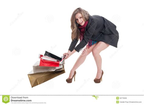 dragging but happy shopping dragging heavy bags stock photo image 50776569