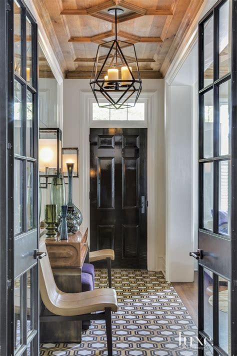 transitional white entry hallway  black door dom