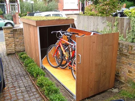 placing outdoor bike storage shed in garden landscape