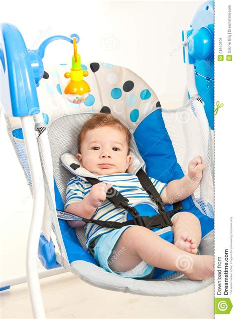 swing for baby boy baby boy in swing royalty free stock image image 31540506