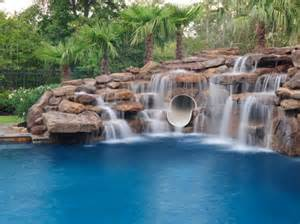 how to build a waterfall into a pool swimming pool cave and waterfall slide platinum pools