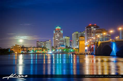 boat canvas delray beach west palm beach skyline moon setting over waterway royal