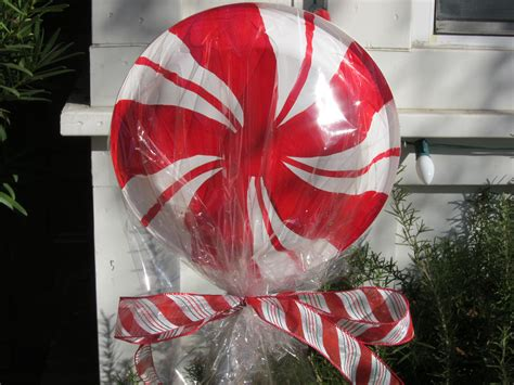 my giant lollipops diy is the perfect holiday yard decoration christmas holiday pinterest